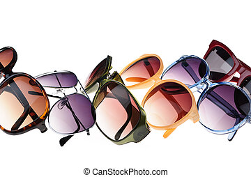 Sunglasses - Different styles of tinted sunglasses on white...