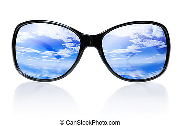 Sunglasses - Blue skies and sea reflecting in sunglasses...
