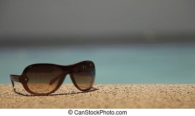 Sunglasses Taken By Hand - Sunglasses at Pool