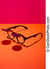 Sunglasses with double glass on a colored background
