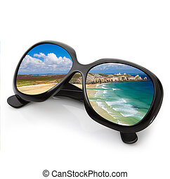 sunglasses with sea on white background