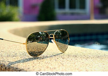 Sunglasses with the pool