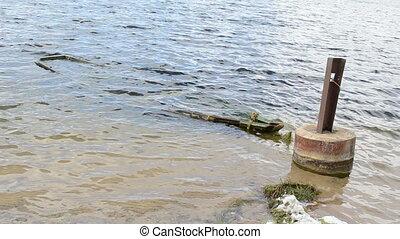 sunken boast wave lake - Sunken wooden row boat rowboat...