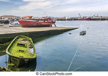 Old wreck and covered with algae on Vilaxoan fishing port
