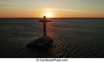 Sunken Cemetery cross in Camiguin island, Philippines. -...