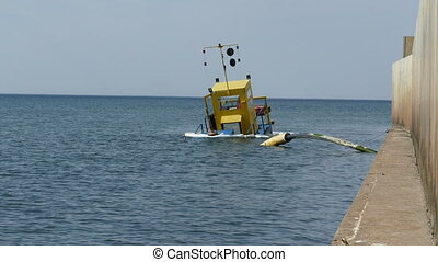 Sunken dredging barge in small port - Recently sunken...