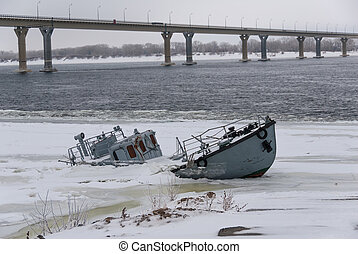Sunken ship in a frozen river