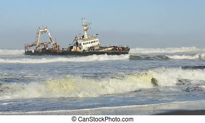 Sunken ship in the ocean breakers grounded at Namibia...
