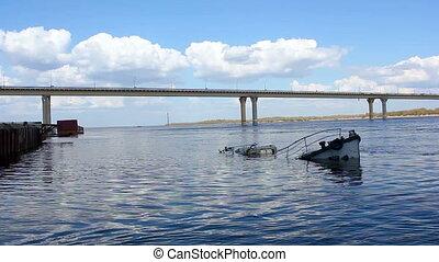Sunken ship in the river
