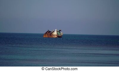 Sunken ship in the sea at sunny day
