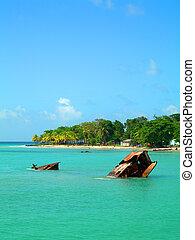 sunken ship on shores of corn island nicaragua - rusting...