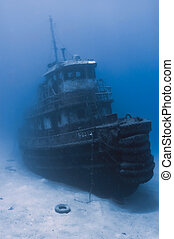 """A sunken tugboat emerges out of the gloomy water.... located in """"Wreck Alley"""" of Cooper Island, BVI's."""