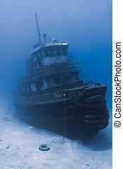 Sunken tugboat - A sunken tugboat emerges out of the gloomy...