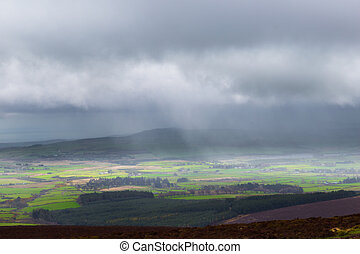 Sunlight and rain falling on Glen of the Downs