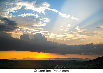 sunlight and sunray over mountain in sunset