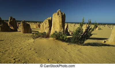 sunlight of Pinnacles Desert - sunset panorama through the...