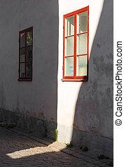 Sunlight on a house wall