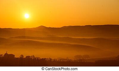 sunlight on misty countryside landscape