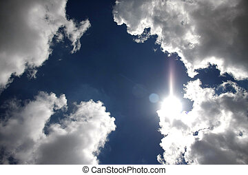 sunlight reflex on clouds - sunlight reflex above white...