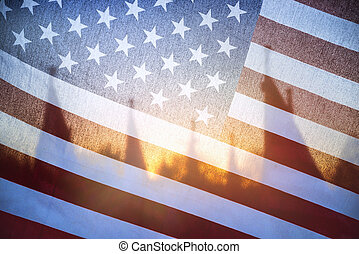 Sunlight shining through of American flag in the morning