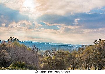 Sunlight Shinning Through the Clouds - Sunlight Shinning...