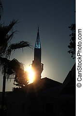 Sunlight sparkling through minaret