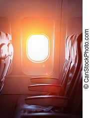 Sunlight through window on a commercial airliner aircraft.