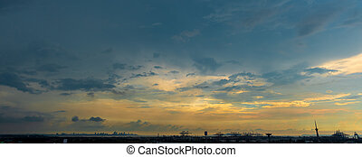 Sunlight with dramatic sky on dark background during sunset. cloudscape in city.