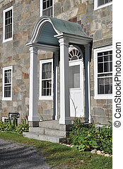 Sunlit arched door on stone mansion - Brilliant spring...