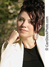 Sunlit Businesswoman - Assured businesswoman.