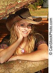 Sunlit Cowgirl - Cowgirl outside enjoying the sunshine rays