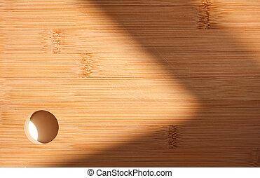 Sunlit cutting board. - Sunlit cutting board with shadow...