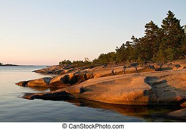 Sunlit rocks.