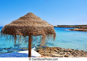sunlounger and umbrella in Ibiza, Spain