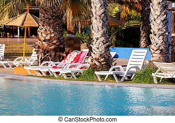 sunloungers on swimming pool - sun loungers on swimming pool...