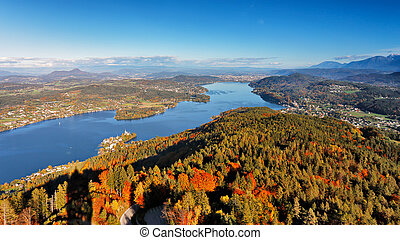 Sunny autumn day on the lake in mountains of south Austria