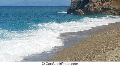 Sunny beach with sea waves