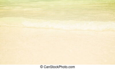 sunny beach with water waves