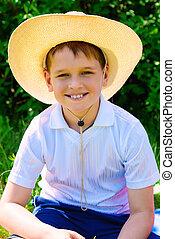 sunny boy in straw hat