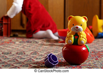 Sunny child\\\'s room - Rocking bear toy against a...