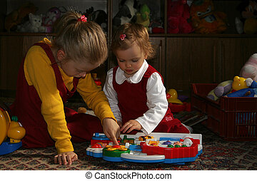 Sunny child\\\'s room - Two sisters playing together