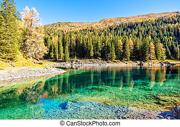 Sunny Day At Mountain Lake At Autumn Alps. Lake Obernberg is a mountain lake located in the Stubai Alps in Tyrol, Austria.
