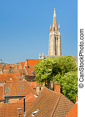 Sunny day in Bruges - The Our Lady Church in Bruges in a...