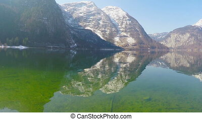 """""""Sunny day in mountains, smooth lake surface, reflection in water, meditation"""""""