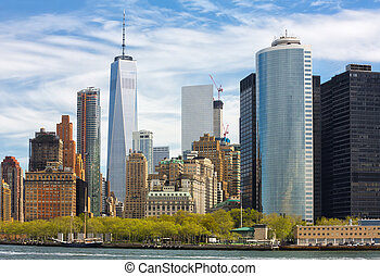 Manhattan skyline in NYC - Sunny day in New York. View of...