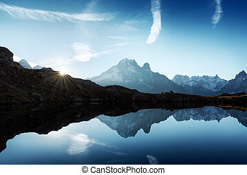 Sunny day on Chesery lake in France Alps