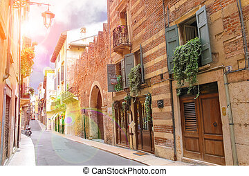 Sunny day on the streets of ancient Italian city