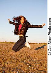 Sunny girl jumping