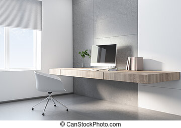 Sunny home office with stylish wooden table without legs, white chair and modern computer monitor
