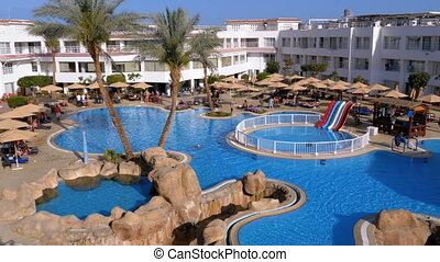 Sunny Hotel Resort with Luxury Blue Swimming Pool, Beach Umbrellas and Sunbeds in Egypt